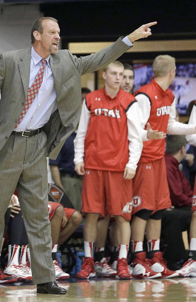 Utah head coach Larry Krystkowiak argues a call with the referee during the second half against St. Mary's of an NCAA college basketball game in the first round of the National Invitational Tournament in Moraga, Calif., Tuesday, March 18, 2014. St Mary's won 70-58