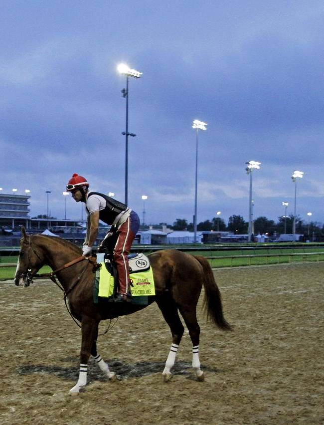 Exercise rider William Delgado takes Kentucky Derby hopeful California Chrome for a morning workout at Churchill Downs Wednesday, April 30, 2014, in Louisville, Ky