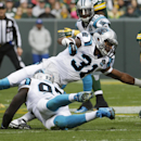 Green Bay Packers' Aaron Rodgers runs for a first down during the first half of an NFL football game against the Carolina Panthers Sunday, Oct. 19, 2014, in Green Bay, Wis The Associated Press