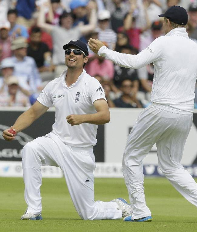 England's captain Alastair Cook celebrates with Joe Root, right, as he catches out India's Stuart Binny for 0 during the fourth day of the second test match between England and India at Lord's cricket ground in London, Sunday, July 20, 2014