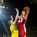 Michigan forward Mark Donnal defends Wisconsin forward Frank Kaminsky (44) during the first half of an NCAA college basketball game in Ann Arbor, Mich., Saturday, Jan. 24, 2015. (AP Photo/Tony Ding)