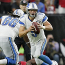 Detroit Lions quarterback Matthew Stafford (9) avoids a sack during the first half of an NFL football game against the Arizona Cardinals, Sunday, Nov. 16, 2014, in Glendale, Ariz The Associated Press