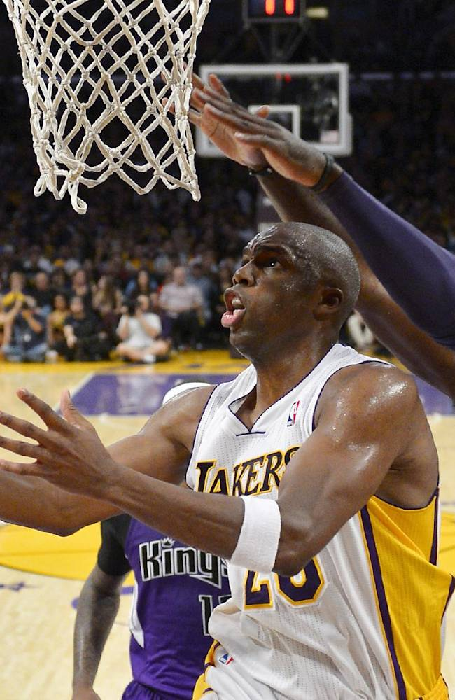 Los Angeles Lakers guard Jodie Meeks, left, puts up a shot as Sacramento Kings forward Patrick Patterson defends during the second half of an NBA basketball game, Sunday, Nov. 24, 2013, in Los Angeles