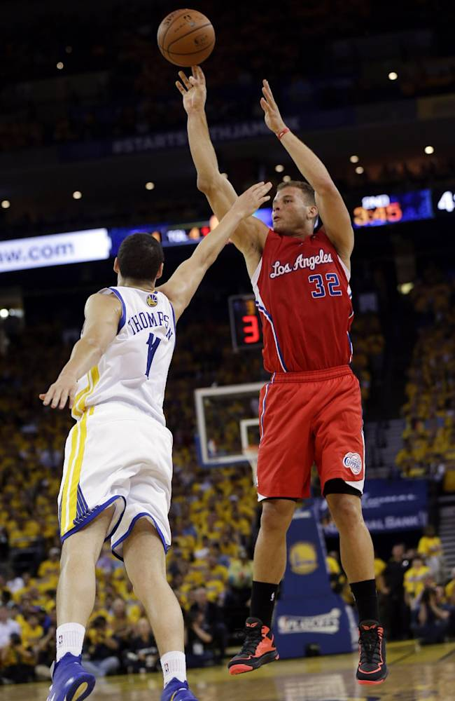 Los Angeles Clippers' Blake Griffin, right, shoots over Golden State Warriors' Klay Thompson during the first half in Game 6 of an opening-round NBA basketball playoff series on Thursday, May 1, 2014, in Oakland, Calif