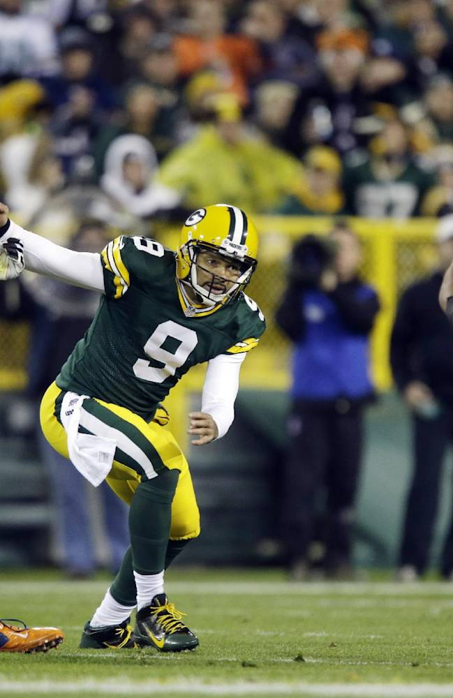 Green Bay Packers quarterback Seneca Wallace watches as Chicago Bears' Julius Peppers (90) intercepts a pass during the first half of an NFL football game Monday, Nov. 4, 2013, in Green Bay, Wis