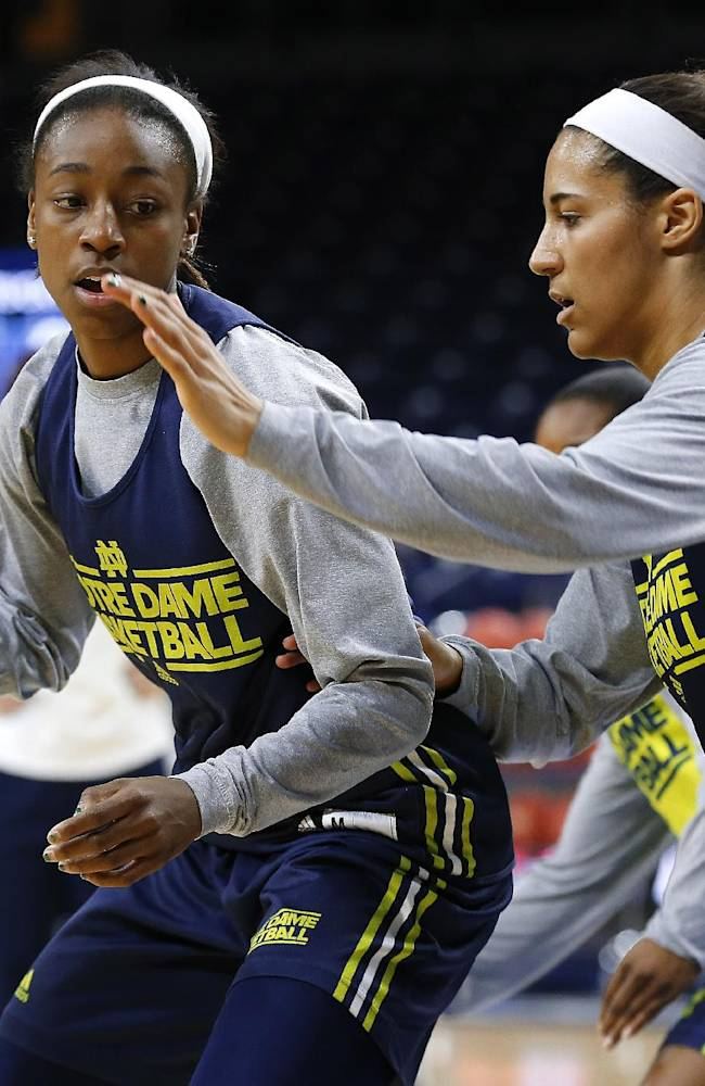 Notre Dame guard Jewell Loyd, left, drives on Taya Reimer during their NCAA women's college basketball tournament practice at the Purcell Pavilion in South Bend, Ind., Friday, March 28, 2014. Notre Dame plays Oklahoma State Saturday