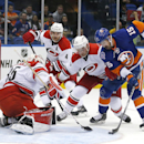 Carolina Hurricanes goalie Drew MacIntyre (35) stops a shot by New York Islanders right wing Cal Clutterbuck (15) as Hurricanes defenseman Andrej Sekera (4) and forward Brad Malone (24) help out during the second period of a preseason NHL hockey game Wedn