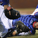 Chicago Cubs catcher Welington Castillo misses a pop foul by Pittsburgh Pirates' Russell Martin during the second inning of a baseball game in Chicago, Wednesday, April 9, 2014. Martin struck out on the at-bat The Associated Press