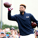 IMAGE DISTRIBUTED FOR VISA - New York Giants' Odell Beckham Jr. catches a pass from New Orleans Saints' Drew Brees while setting the Guinness World Record for the most one handed catches in one minute with 33, Thursday, Jan. 29, 2015 in Scottsdale, Ariz.