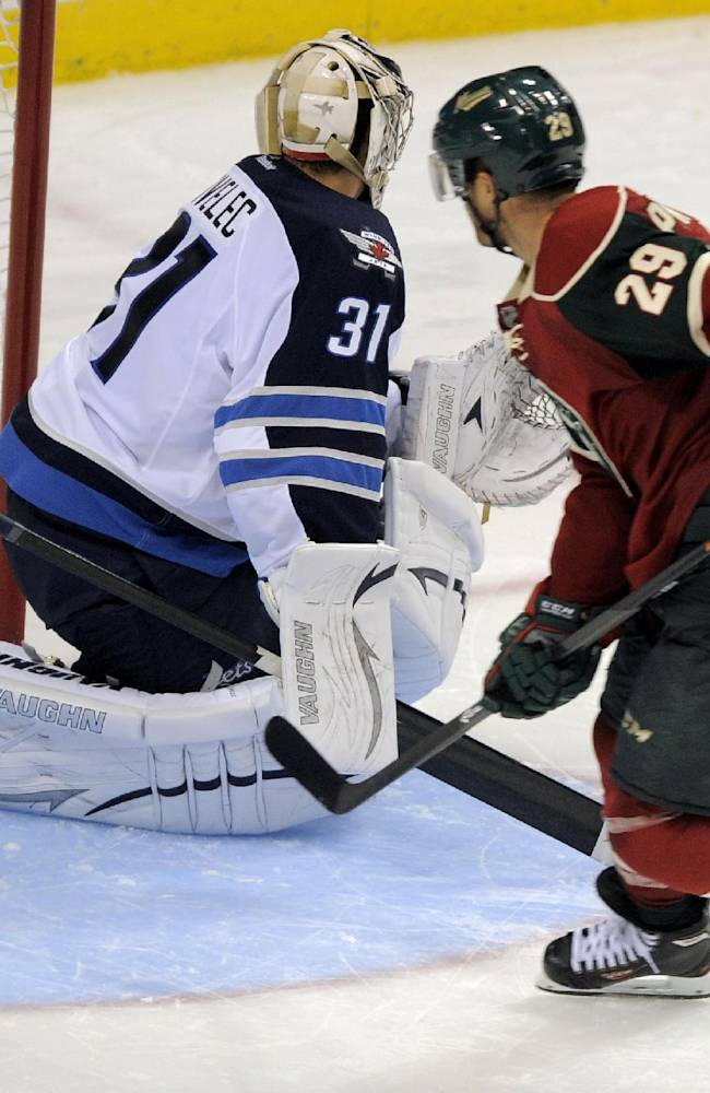 Minnesota Wild's Jason Pominville (29) beats Winnigeg Jets goalie Ondrej Pavelec, left, for the winning goal in a shootout during an NHL hockey game on Saturday, Sept. 21, 2013, in St. Paul, Minn. Minnesota won 4-3