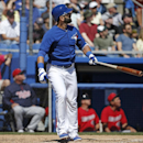 Toronto Blue Jays' Jose Bautista watches his solo home run off Minnesota Twins relief pitcher Glen Perkins during the fourth inning of a spring training baseball game in Dunedin, Fla., Saturday, March 8, 2014 The Associated Press