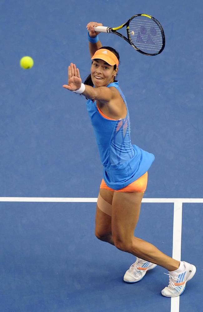 Ana Ivanovic of Serbia eyes the ball to hit a smash to Samantha Stosur of Australia during their third round match at the Australian Open tennis championship in Melbourne, Australia, Friday, Jan. 17, 2014