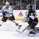 Los Angeles Kings goalie Martin Jones, right, blocks a shot by San Jose Sharks center Patrick Marleau during the first period of an NHL hockey game in Los Angeles, Thursday, Dec. 19, 2013. (AP Photo/Chris Carlson)
