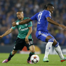 Chelsea's Didier Drogba, right, fouls Schalke's Sidney Sam during the Champions League Group G soccer match between Chelsea and Schalke 04 at Stamford Bridge stadium in London Wednesday, Sept. 17, 2014