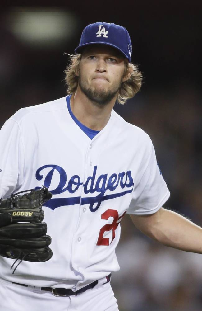 In this Oct. 7, 2013, file photo, Los Angeles Dodgers starting pitcher Clayton Kershaw reacts after Atlanta Braves' Elliot Johnson grounded out to end the top of the second inning of Game 4 in the National League baseball division series in Los Angeles. Led by Kershaw, the Dodgers have one of baseball's best rotations. They recently locked up the two-time Cy Young Award winner with a $215 million, seven-year contract. Kershaw, Zack Greinke and Hyun-Jin Ryu will be the top three starters again