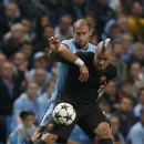 Manchester City's Pablo Zabaleta, left, holds Roma's Radja Nainggolan as he tries to control the ball during a Champions League group E soccer match between Manchester City and Roma at the Etihad Stadium, Manchester, England, Tuesday, Sept. 30, 2014