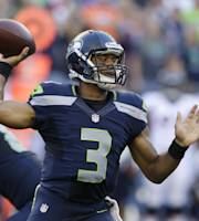 Seattle Seahawks quarterback Russell Wilson passes in the first half of a preseason NFL football game against the Denver Broncos, Saturday, Aug. 17, 2013, in Seattle. (AP Photo/Elaine Thompson)