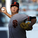 San Francisco Giants starting pitcher Matt Cain throws against the Los Angeles Dodgers in the first inning of a baseball game Sunday, April 6, 2014, in Los Angeles The Associated Press