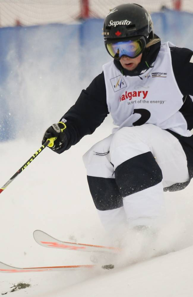 Canada's Justine Dufour-Lapointe competes during the women's World Cup freestyle moguls event in Calgary, Alberta, Saturday, Jan. 4, 2014
