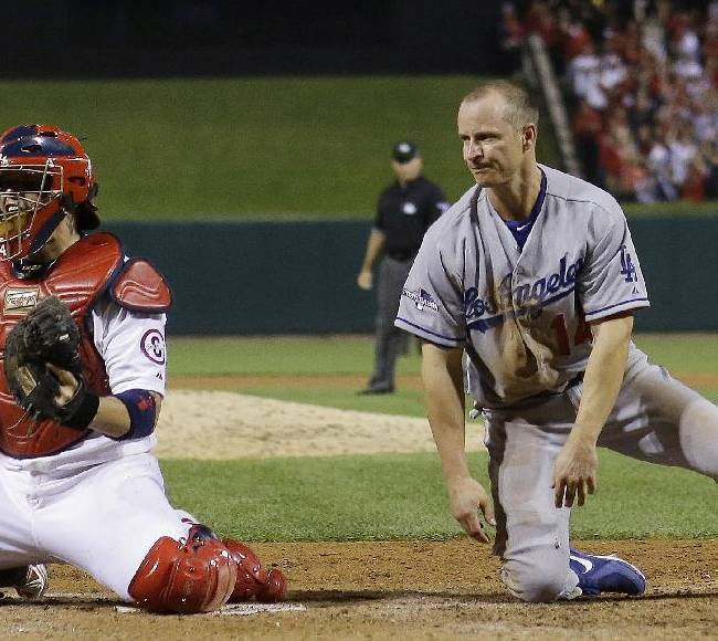 Dodgers, Cardinals go to extras in NLCS opener