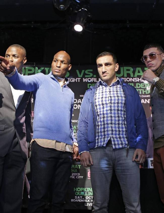 From left, boxers Deontay Wilder of Tuscaloosa, Ala., Peter Quillan of New York, Bernard Hopkins, of Philadelphia, Karo Murat of Germany, Gabriel Rosado of Philadelphia, and Nicolai Firtha of Akron, Ohio, pose for a photograph during a news conference, Wednesday, Oct. 23, 2013, in New York. Hopkins will square off against Murat, Quillan will square off against Rosada and Wilder will square off against Firtha, on Saturday in Atlantic City, N.J