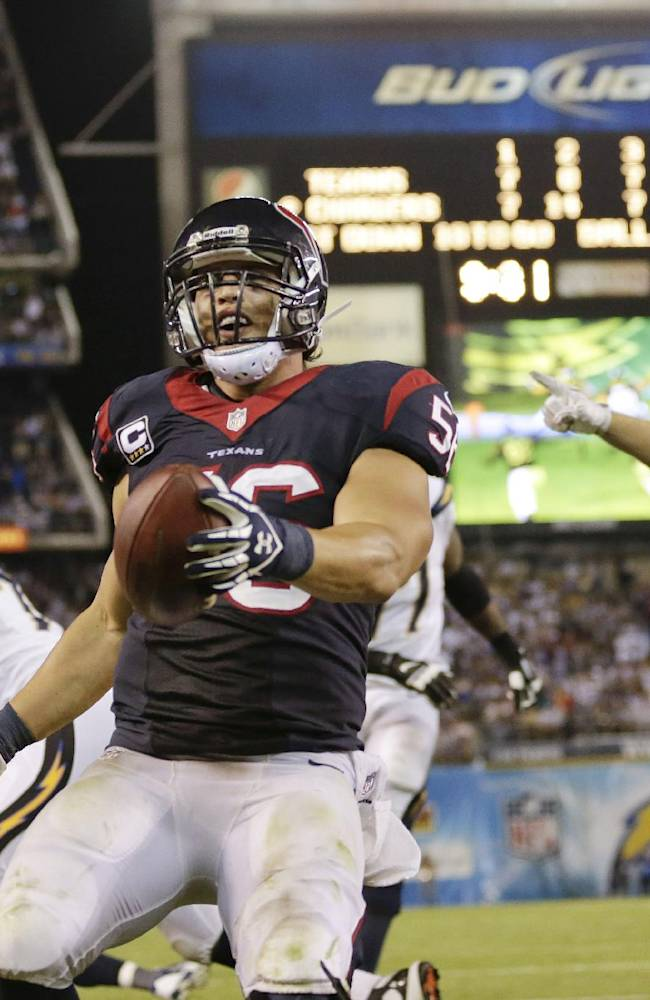 In this Sept. 9, 2013, file photo, Houston Texans inside linebacker Brian Cushing, center, celebrates after returning an interception for a touchdown during the second half of an NFL football game against the San Diego Chargers in San Diego. Cushing didn't need long to show he was back after season-ending knee surgery. The linebacker returned an interception for a touchdown, rallying the Texans in their opener