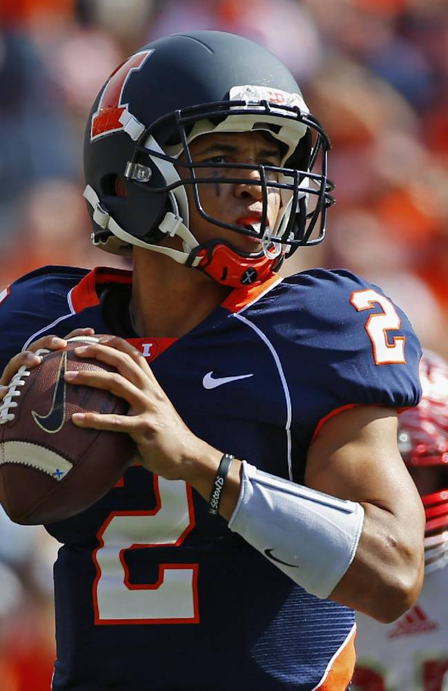 In this Sept. 28, 2013 file photo, Illinois quarterback Nathan Scheelhaase throws a pass against Miami (Ohio) during an NCAA college football game in Champaign, Ill. Scheelhaase's father, Nathan Creer, has been banned from campus for a year after his arrest over an altercation at a football game against Michigan State on Saturday, Oct. 26. Creer pleaded not guilty Monday, Oct. 28, 2013, to resisting and obstructing an officer
