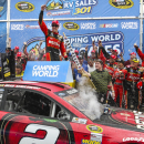 Brad Keselowski celebrates in Victory Lane after winning the NASCAR Sprint Cup Series auto race at New Hampshire Motor Speedway on Sunday, July 13, 2014, in Loudon, N.H. (AP Photo/Cheryl Senter)