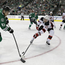 New Jersey Devils defenseman Peter Harrold (10) defends the goal against Dallas Stars right wing Ales Hemsky (83) during the first period of an NHL hockey game Saturday, Dec. 13, 2014, in Dallas The Associated Press