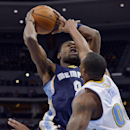 Memphis Grizzlies guard Tony Allen (9) is fouled by Denver Nuggets forward Darrell Arthur during the second quarter of an NBA basketball game on Monday, March 31, 2014, in Denver The Associated Press