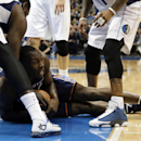 Charlotte Bobcats' Bismack Biyombo of Congo grabs a loose ball on the court against Dallas Mavericks' Samuel Dalembert of Haiti, left, and Monta Ellis, right, in the first half of an NBA basketball game, Tuesday, Dec. 3, 2013, in Dallas The Associated Pre