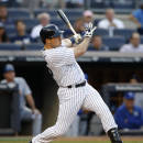 New York Yankees' Mark Teixeira follows through on a first-inning, two-run home run in a baseball game against the Kansas City Royals at Yankee Stadium in New York, Tuesday, May 26, 2015. (AP Photo/Kathy Willens)