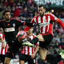 Sunderland's Steven Fletcher, right, vies for the ball with Fulham's Bryan Ruiz, left, during the English FA Cup fourth round soccer match between Sunderland and Fulham at the Stadium of Light, Sunderland, England, Saturday, Jan. 24, 2015