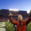 FILE - In this Oct. 4, 2014, file photo, Georgia head coach Mark Richt gestures towards the band after defeating Vanderbilt 44-17 in an NCAA college football game in Athens, Ga. Georgia football coach Richt has received a two-year contract extension that ties him to the Bulldogs through 2019 and increases his salary to $4 million a year. The school's executive committee approved the new contract Wednesday, Jan. 21, 2015, boosting Richt from $3.2 million a year. (AP Photo/John Bazemore, File)