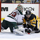 Pittsburgh Penguins' Chris Kunitz (14) gets a shot behind Minnesota Wild goalie Niklas Backstrom (32) for a goal during the second period of an NHL hockey game in Pittsburgh on Tuesday, Jan. 13, 2015 The Associated Press