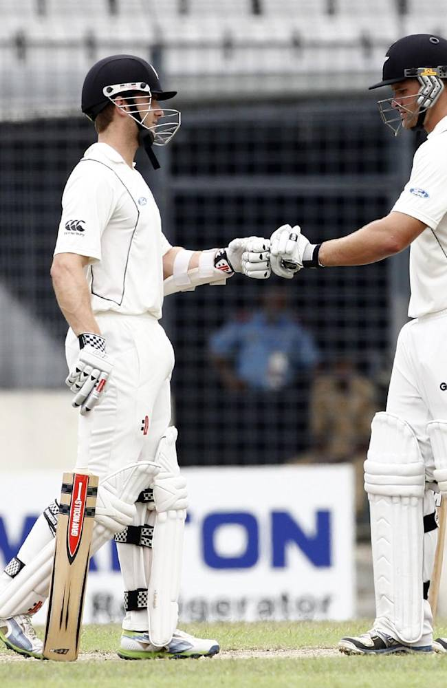 New Zealand's Kane Williamson, left, and Corey Anderson support each other on the third day of the second cricket test match against Bangladesh in Dhaka, Bangladesh, Wednesday, Oct. 23, 2013