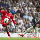 Liverpool's Daniel Sturridge, left, shoots past Tottenham Hotspur's Etienne Capoue, during their English Premier League soccer match at White Hart Lane, London, Sunday, Aug. 31, 2014 (AP Photo/Bogdan Maran)