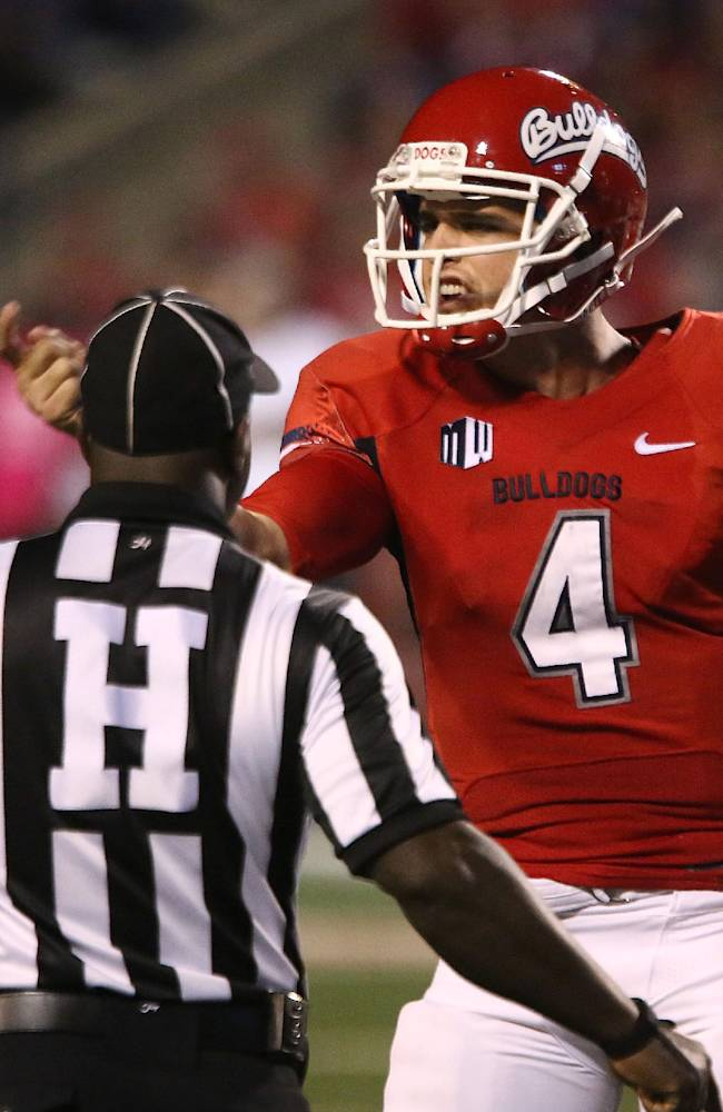 Fresno State' quarterback Derek Carr (4) yells at the UNLV bench during the first half of an NCAA college football game Saturday, Oct. 19, 2013, in Fresno, Calif