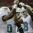 Miami Dolphins wide receiver Brandon Gibson (10) celebrates his touchdown against the Atlanta Falcons with Miami Dolphins wide receiver Rishard Matthews (18) during the first half of an NFL preseason football game, Friday, Aug. 8, 2014, in Atlanta The Ass