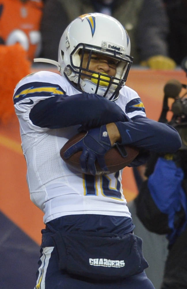 San Diego Chargers wide receiver Keenan Allen (13) celebrates after catching a 16-yard touchdown pass against the Denver Broncos in the fourth quarter of an NFL AFC division playoff football game, Sunday, Jan. 12, 2014, in Denver
