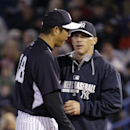 New York Yankees manager Joe Girardi, right, congratulates starting pitcher Hiroki Kuroda after taking the ball from him in the third inning of a spring training baseball game against the Detroit Tigers in Tampa, Fla., Friday, March 7, 2014 The Associated