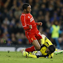 Liverpool's Raheem Sterling, left, is stopped by Chelsea's goalkeeper Thibaut Courtois during the English League Cup semifinal second leg soccer match between Chelsea and Liverpool at Stamford Bridge stadium in London, Tuesday, Jan. 27, 2015