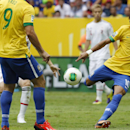 Brazil's Neymar scores the opening goal during the opening match between Brazil and Japan in group A of the soccer Confederations Cup at the National Stadium in Brasilia, Brazil, Saturday, June 15, 2013. (AP Photo/Eugene Hoshiko)