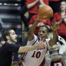 Rutgers' Mike Poole (10) passes around Louisville's Luke Hancock during the first half of an NCAA college basketball game on Wednesday, Feb. 6, 2013, in Piscataway, N.J. (AP Photo/Mel Evans)