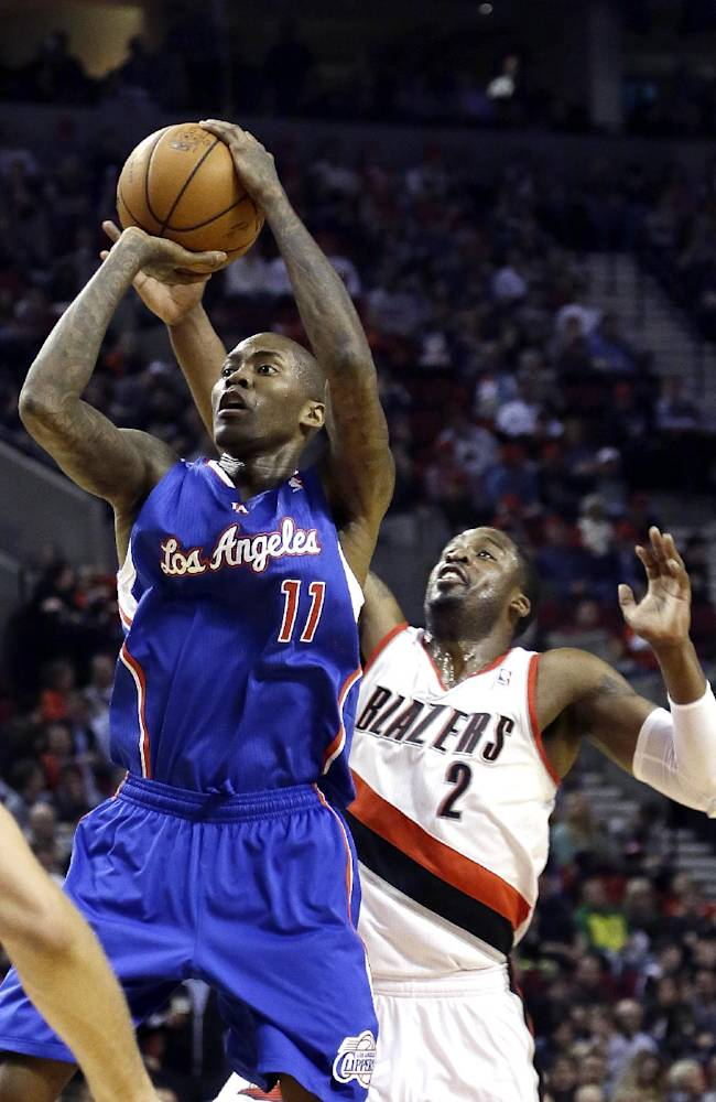 Los Angeles Clippers guard Jamal Crawford, left, shoots as Portland Trail Blazers guard Wesley Matthews defends during the first half of an NBA basketball game in Portland, Ore., Wednesday, April 16, 2014