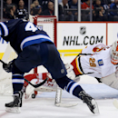 Winnipeg Jets' Devin Setoguchi (40) is stopped by Calgary Flames' goaltender Reto Berra (29) during second period NHL hockey action in Winnipeg Monday, Nov. 18, 2013 The Associated Press