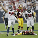 In this Sept. 7, 2014, file photo, Houston Texans' J.J. Watt celebrates after he sacked Washington Redskins' Robert Griffin III (10) during the second quarter of an NFL football game in Houston. The Houston Texans defensive end leads the NFL in quarterbac