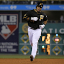 Pittsburgh Pirates' Pedro Alvarez (24) rounds second after hitting a solo home run off St. Louis Cardinals starting pitcher Shelby Miller during the fourth inning of a baseball game in Pittsburgh Friday, April 4, 2014. It was Alvarez's second homer of the