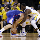 Los Angeles Clippers' Blake Griffin, left, is defended by Golden State Warriors' Draymond Green during the second half in Game 3 of an opening-round NBA basketball playoff series on Thursday, April 24, 2014, in Oakland, Calif. Los Angeles won 98-96 The As