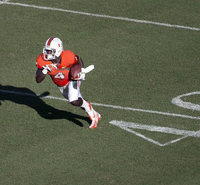Miami's Phillip Dorsett runs the ball for a short gain during the second half of an NCAA college football game in Miami Gardens, Fla. against Georgia Tech, Saturday, Oct. 5, 2013. Miami won 45-30